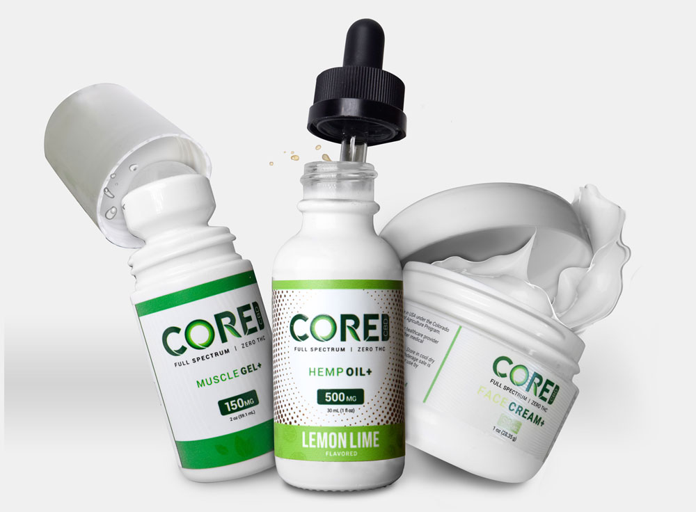 A selection of Core CBD creams and oils in green and white containers.